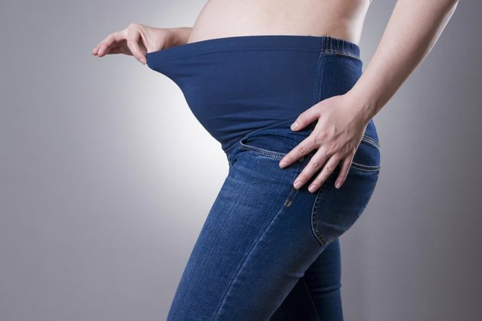 pregnant woman wearing stretch-top jeans