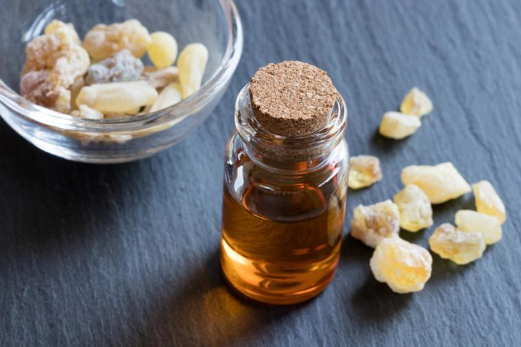 frankincense oil in small glass bottle topped with cork