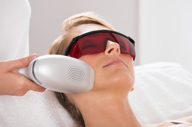 woman getting laser treatment on face