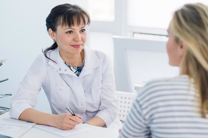 Female doctor listening to female patient