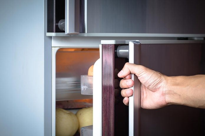 person opening a refrigerator