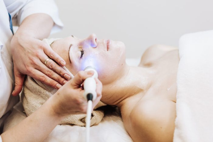 woman getting laser therapy treatment