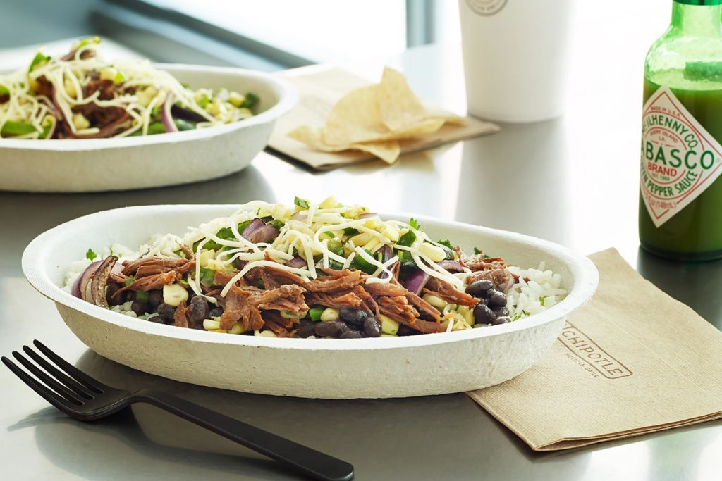 Chipotle burrito bowl on a table.