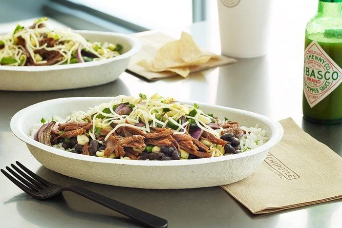 Chipotle burrito bowl on a table.