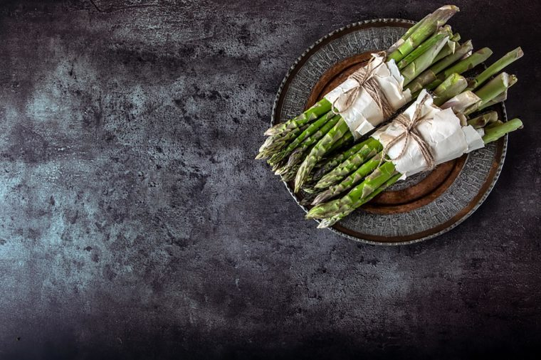 two bundles of asparagus on a plate
