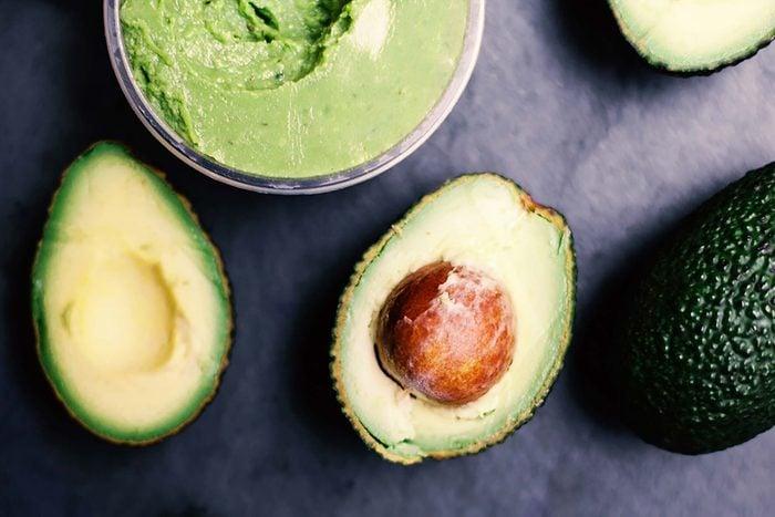 Avocado dip and whole avocados.