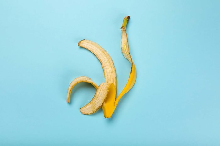 Banana peel on a teal background