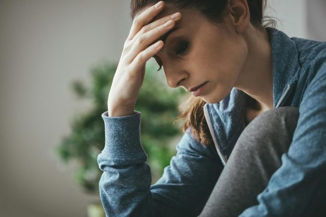 woman looking distraught