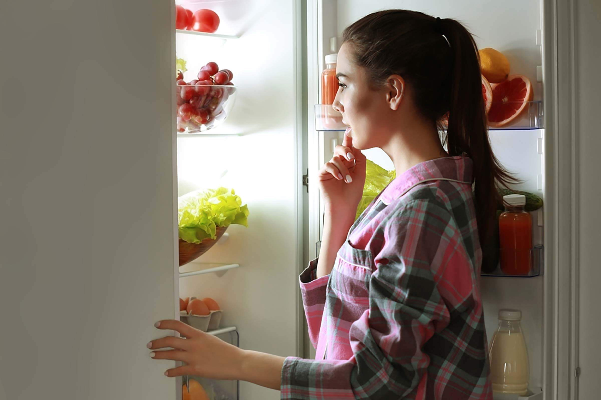 woman looking at fridge