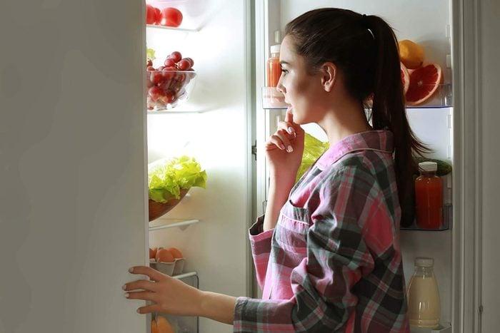 woman looking at fridge