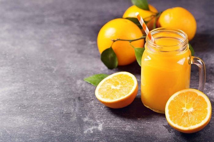 Orange juice and whole oranges.