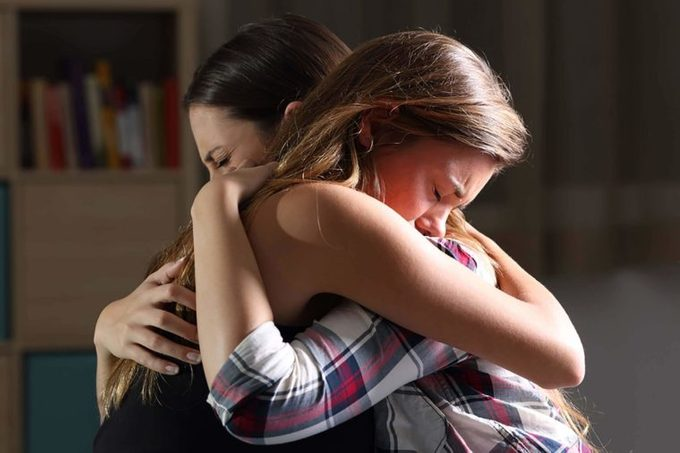 two women consoling