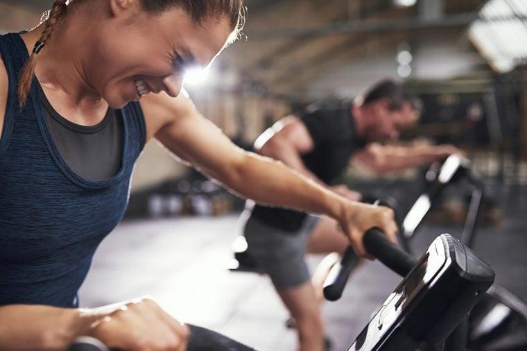 woman straining really hard while exercising