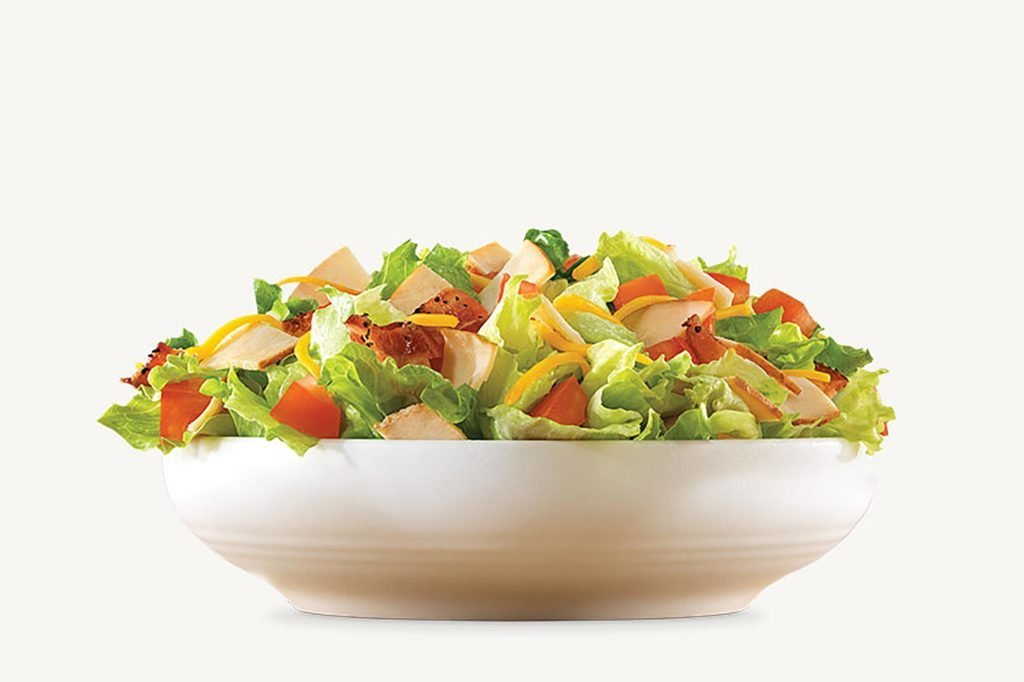 Arby's turkey salad in a white bowl.