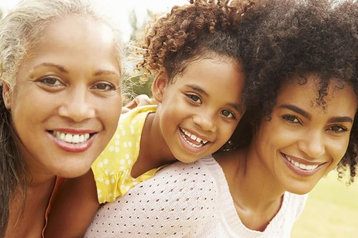 Three generations of women: a grandmother, a mother, and a daughter.