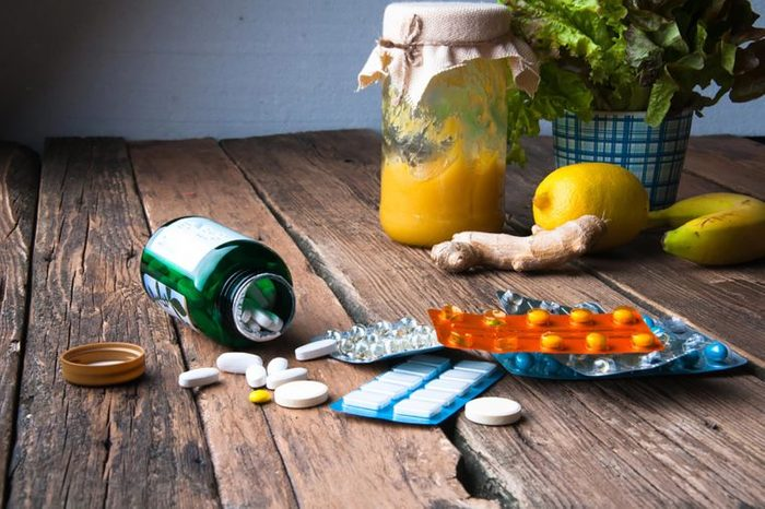 vitamin tablets on a rustic wood table