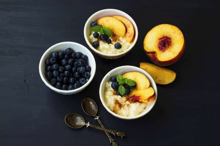 peach and blueberries over Greek yogurt