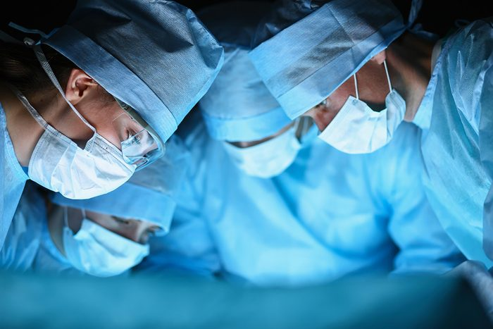 doctors in surgery with facemasks