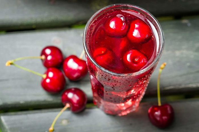 whole cherries on table and with seltzer