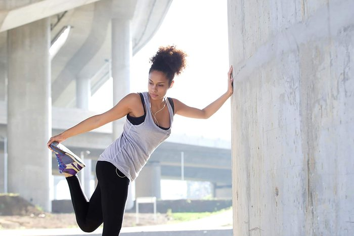 woman outdoors, stretching