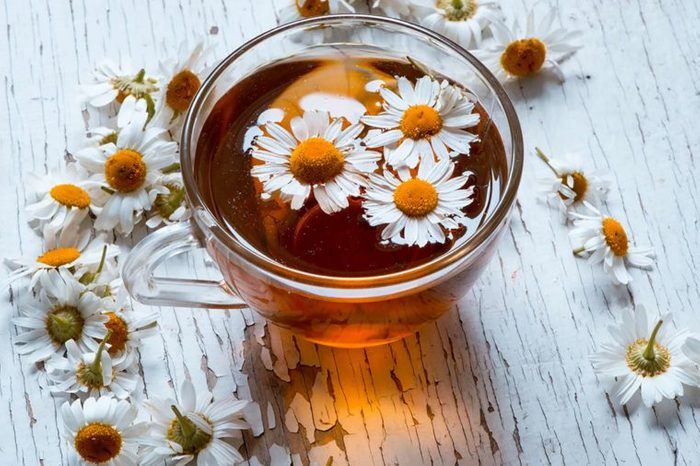 chamomile flowers floating in tea