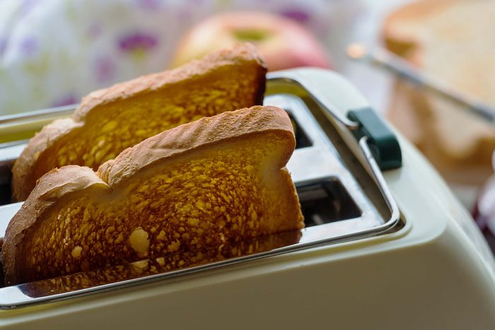 Toast popping up out of toaster