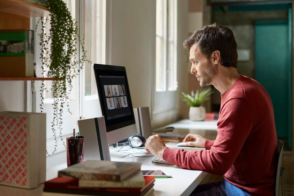 man in a virtual meeting working from home