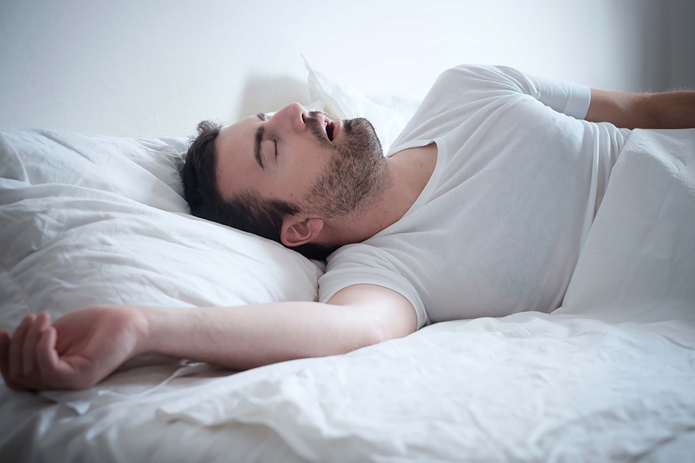 man sleeping with mouth open, sleep apnea, snoring