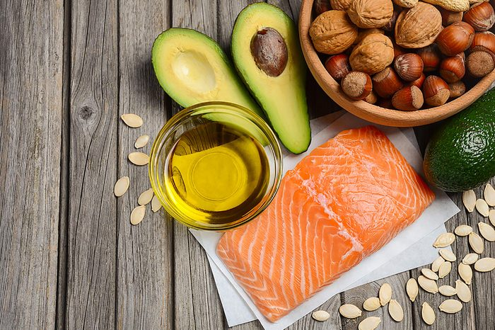 Salmon, olive oil, avocado, nuts, and pumpkin seeds.