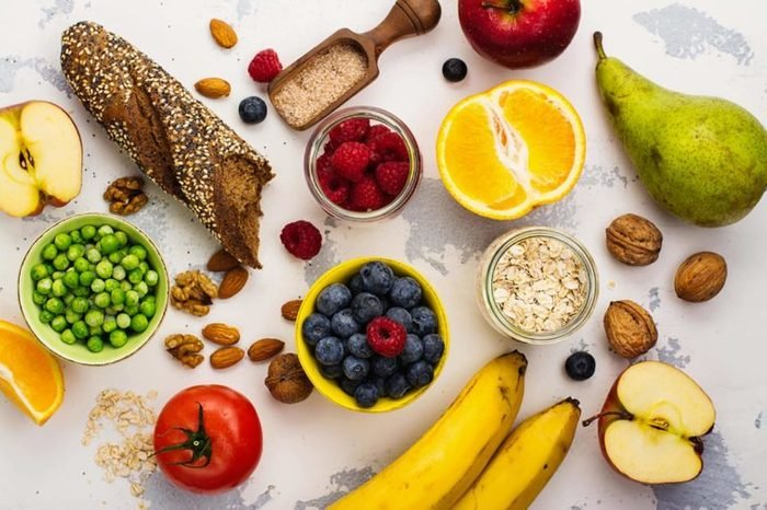 Colorful fruits, nuts, legumes, bread and other fiber-filled foods