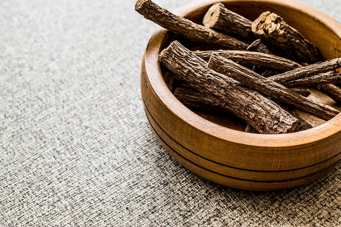 pieces of Licorice root in a wooden bowl