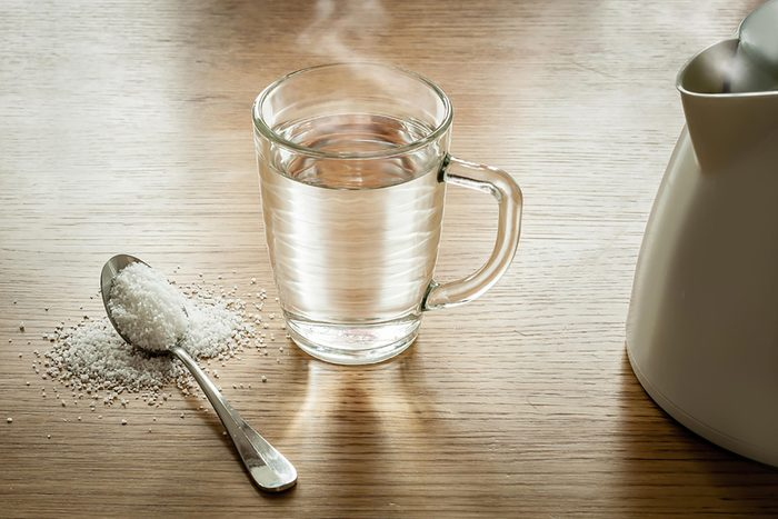 glass with spoon of epson salt for laxative