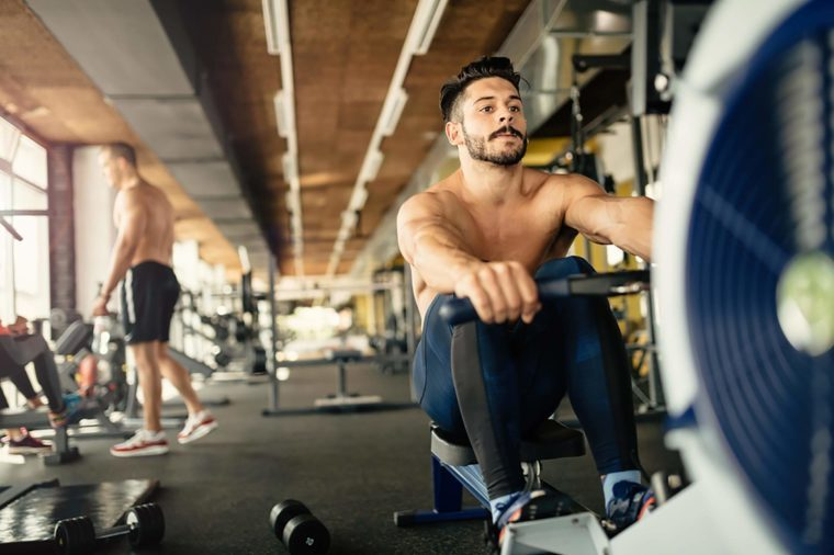 shirtless men working out in a gym