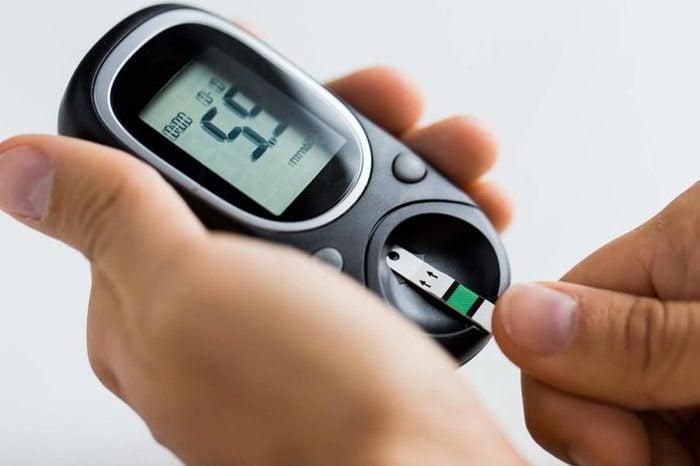 Man testing his blood sugar