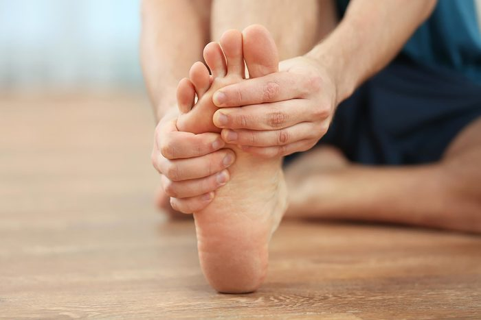 a person massaging his foot