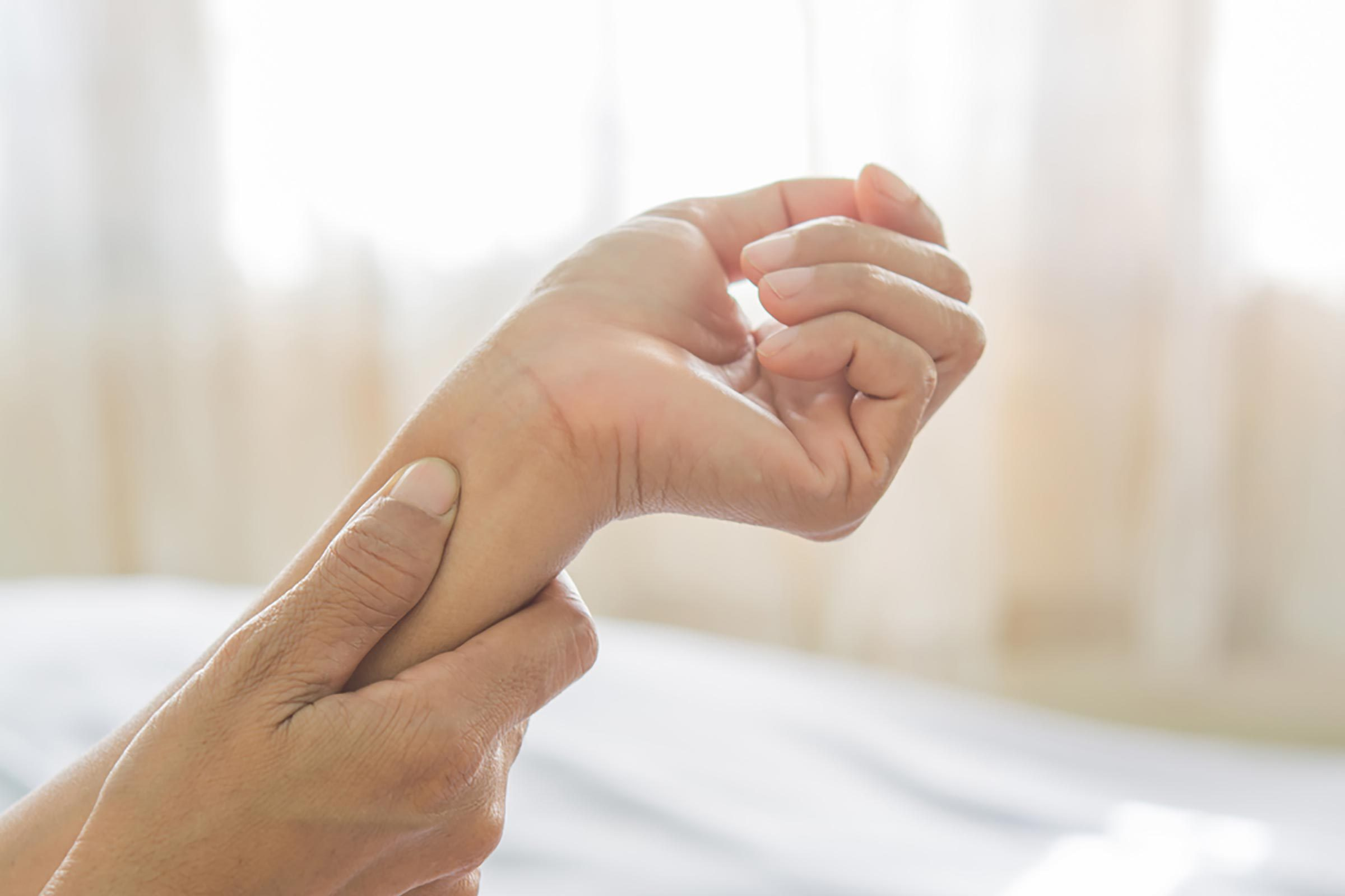 closeup of a person holding her wrist