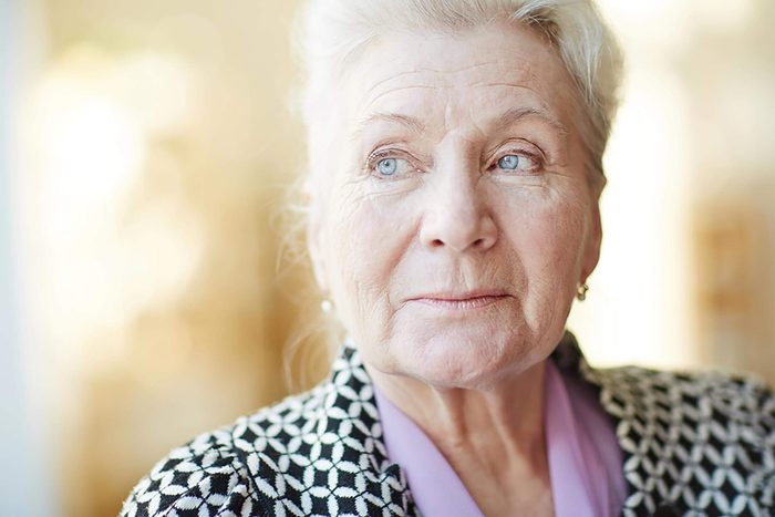 older woman looking into the distance
