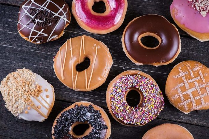 Assortment of glazed doughnuts with different toppings