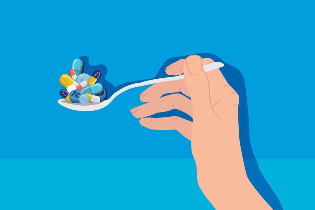 Illustration of a hand holding a spoonful of pills and capsules.