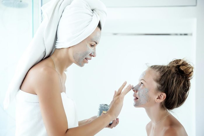 two women with green clay masks