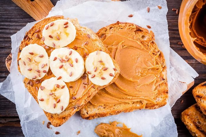 toast with peanut butter, banana, and flaxseeds