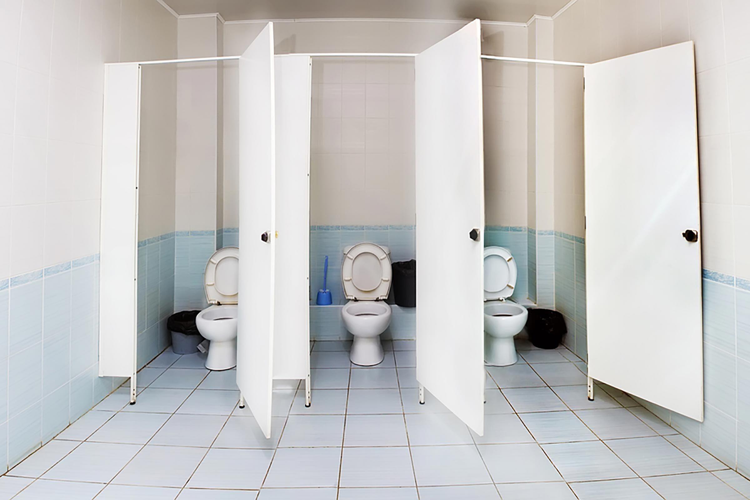 three empty stalls in a bathroom