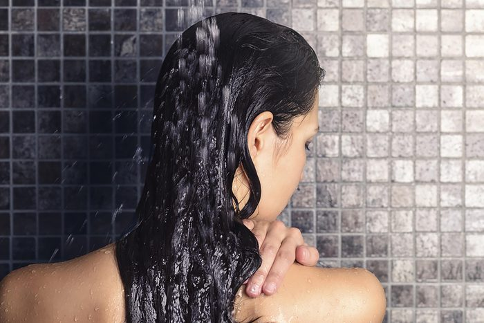 Woman in shower with wet hair