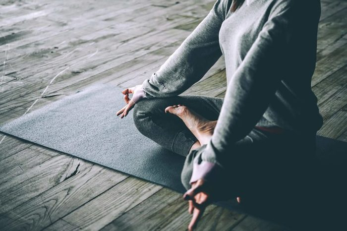 woman in a cross-legged meditative pose