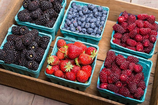 different types of berries in baskets
