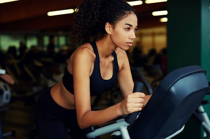 woman at gym on exercise machine