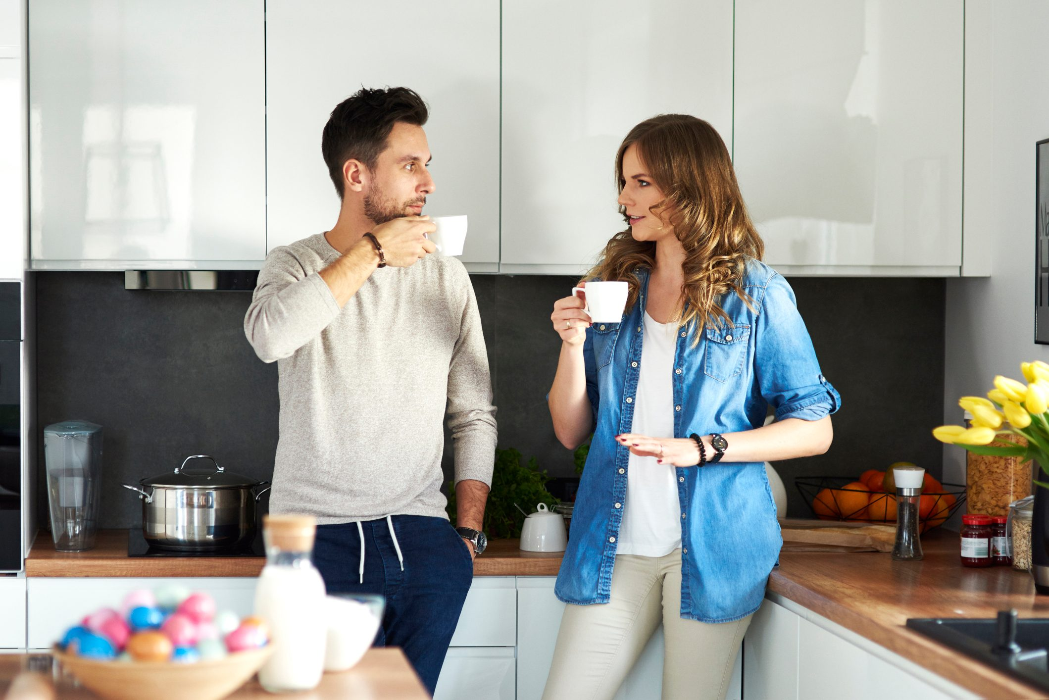 couple talking to each other in kitchen