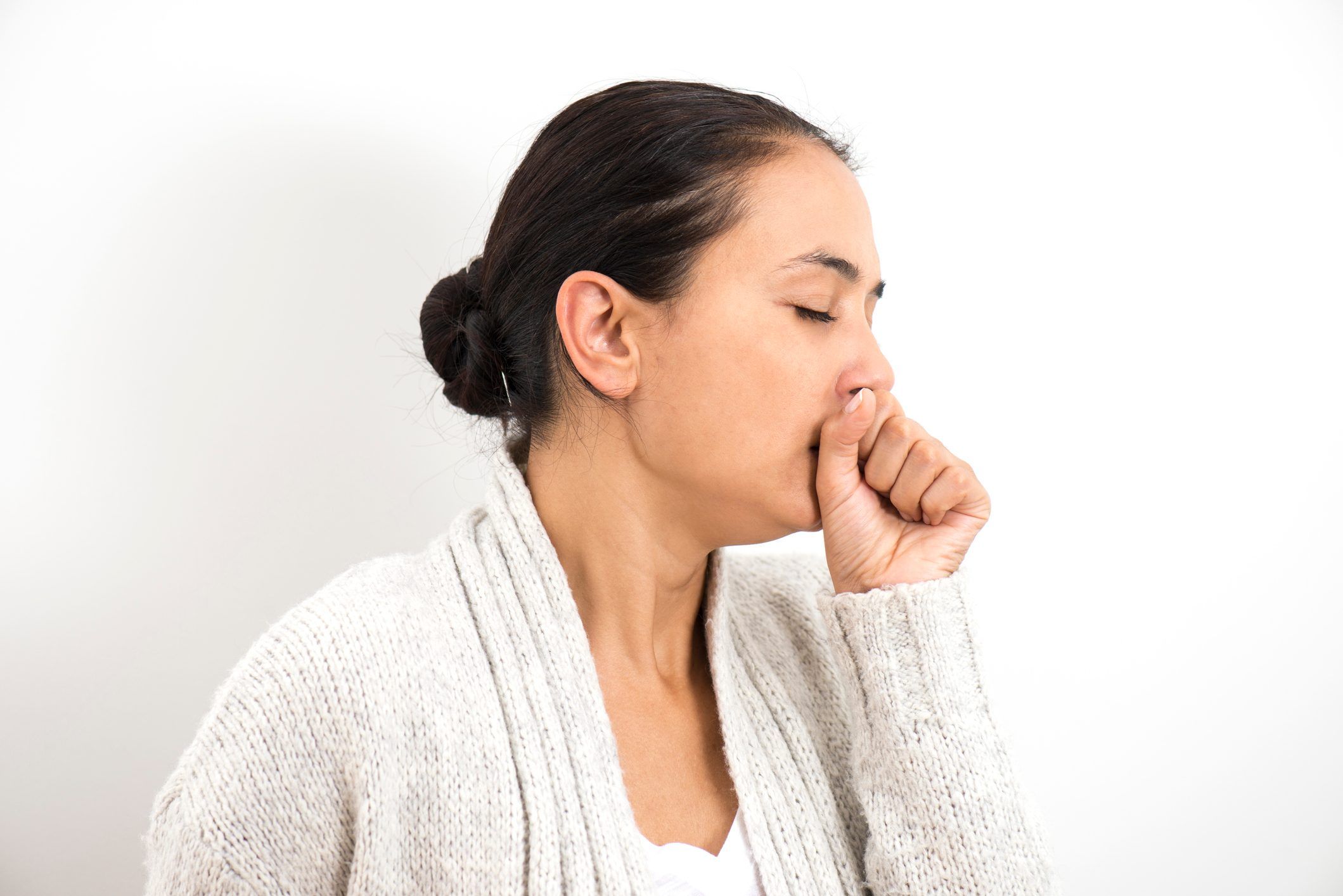 woman coughing clearing throat