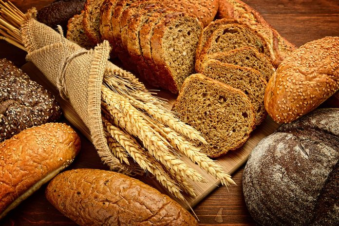 collection of whole grain breads and wheat stems