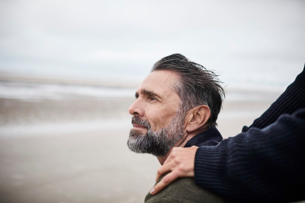 man sitting on the beach